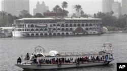 Egyptians enjoy a ride along the Nile river, February 15, 2011