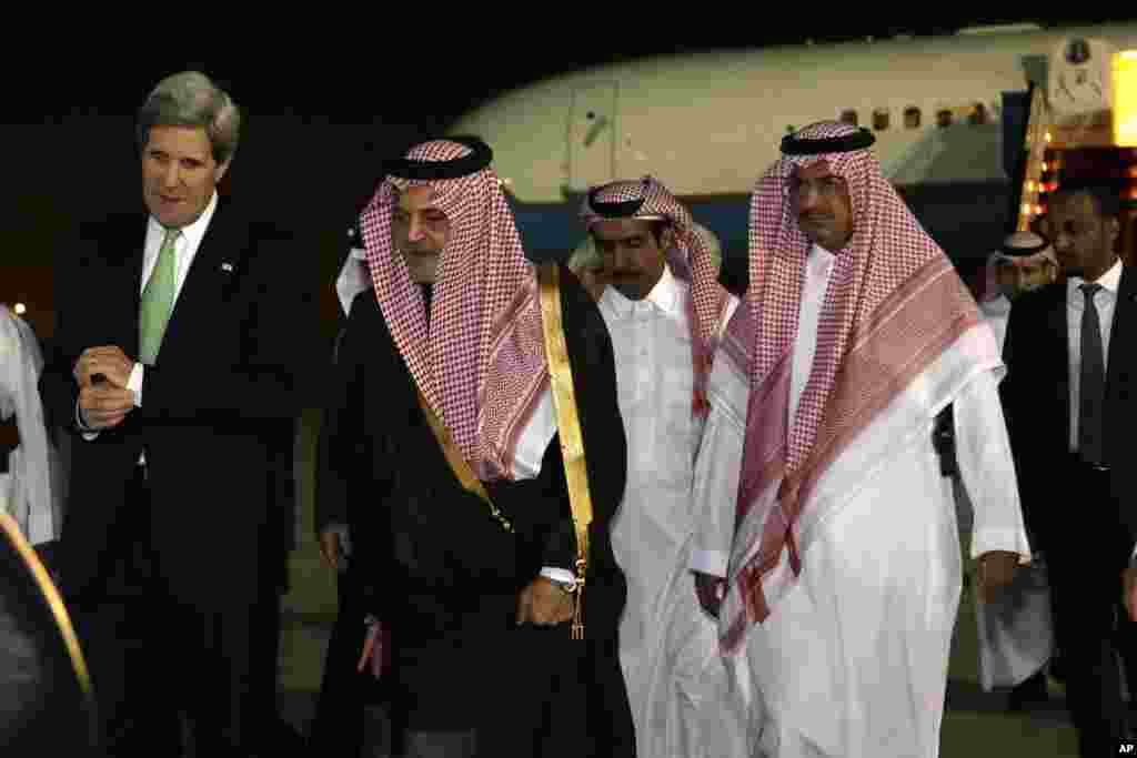 U.S. Secretary of State John Kerry walks with Saudi Foreign Minister Prince Saud al-Faisal on arrival in Riyadh, Saudi Arabia, March 3, 2013.