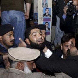 The alleged killer of Governor of Punjab, Salman Taseer, being brought to a court in Islamabad, Pakistan, 05 Jan 2011.