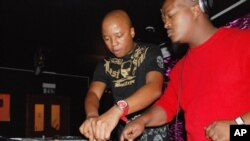 One of the originators of kwaito music, Mahoota (left) with South Africa's DJ Vetkuk, spinning the vibes at a club in Johannesburg