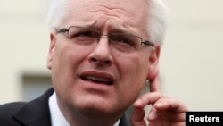 FILE - President Ivo Josipovic of Croatia gestures as he speaks to the media.