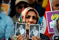 Supporters of the pro-Kurdish Peoples' Democratic Party (HDP) some holding pictures of the party's former co-leader Selahattin Demirtas, currently in prison on charges of leading a terror organisation, chant slogans during a rally announcing him as a presidential candidate in Istanbul, May 4, 2018.