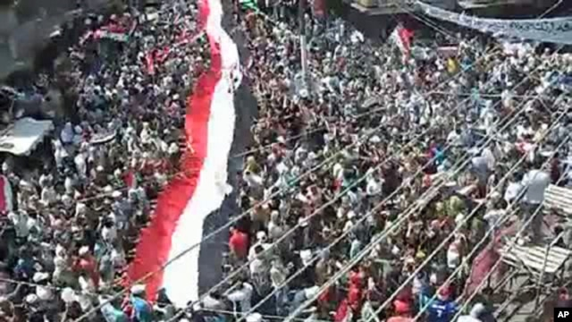An image taken from a video uploaded on YouTube shows Syrian anti-government demonstrators marching in the coastal city of Latakia on August 12, 2011