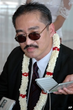 FILE - Khmer Republican Party of Cambodia President Lon Rith, son of Lon Nol who ruled Cambodia from 1970 to 1975, talks to reporters on his arrival at Phnom Penh International Airport, Phnom Penh, Cambodia, April 20, 2008.