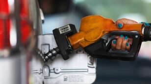 A worker at state-owned Pertamina, the country's main retailer of subsidised fuel, fills a vehicle at a petrol station in Jakarta November 17, 2014. Indonesia's president raised the price of subsidised gasoline and diesel by more than 30 percent on Monday