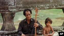 A blind musician plays his traditional Cambodian violin along the promenade at Angkor Wat in Siem Reap on Monday January 22,1996. (AP Photo/Richard Vogel)