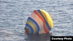 中國男子徐帥軍試圖藉以登陸有爭議島嶼的熱氣球。 (日本第11管區海上保安總部 提供)