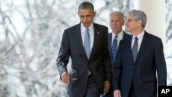 Federal appeals court judge Merrick Garland walks with President Barack Obama and Vice President Joe Biden from the Oval Office to the Rose Garden to be introduced as Obama's nominee for the Supreme Court at the White House, in Washington on March 16, 2016.