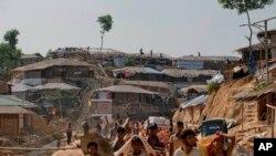 FILE - Rohingya refugees rebuild their makeshift houses, in preparation for the approaching monsoon season at the Kutupalong Rohingya refugee camp in Kutupalong, Bangladesh, April 28, 2018.