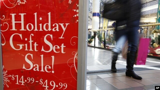 A retail store at the CambridgeSide Galleria mall in Cambridge, Massacjisetts, advertises  holiday sale, December 24, 2012.