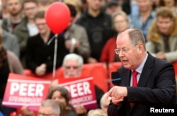 The top-candidate of the Social Democratic Party (SPD) Peer Steinbrueck speaks during an election campaign rally at Roemerberg square in Frankfurt, Germany, Sept. 21, 2013.