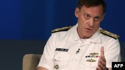U.S. Navy Admiral Michael Rogers, who heads U.S. Cyber Command and the National Security Agency, urges timely access to data. He's shown speaking at a forum in Washington, D.C, May 11, 2015.