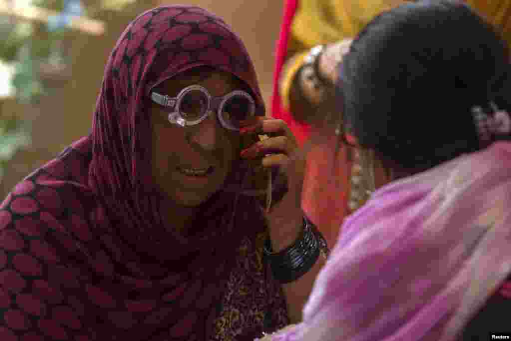 An Afghan refugee has her eyes tested at a health clinic set up by the UNHCR to mark World Refugee Day in Islamabad, June 20, 2014.