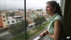 U.S. activist Lori Berenson looks out from her residence in Lima, Peru. Berenson is heading home to New York, two decades after being found guilty of aiding leftist rebels, Nov. 27, 2015.