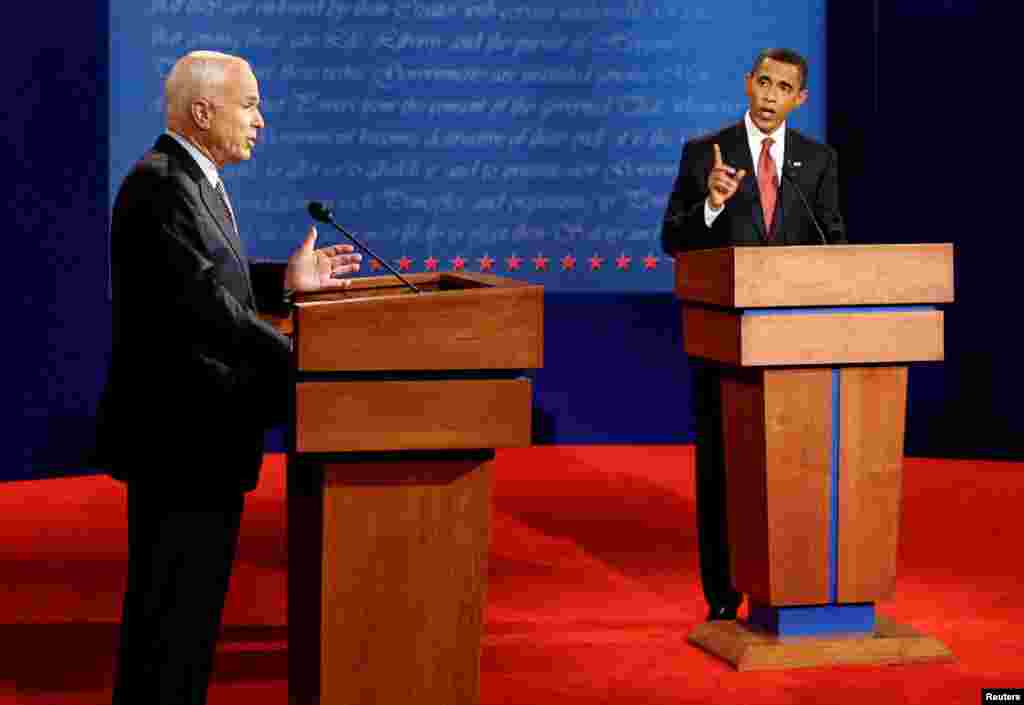 Republican presidential candidate John McCain (L) and Democratic presidential candidate Barack Obama (R) take part in their first 2008 presidential debate at the University of Mississippi in Oxford, Mississippi, Sept. 26, 2008.