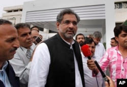 FILE - Pakistan's lower house of parliament on Tuesday elected Shahid Khaqan Abbasi, shown in Islamabad, Pakistan, July 31, 2017, as the country's new prime minister.