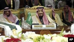 King Salman of Saudi Arabia, center, attends the closing session of the 36th Gulf Cooperation Council Summit in Riyadh, Dec. 10, 2015. The Islamic State has ratcheted up a propaganda campaign against the Gulf kingdom's ruling family, denouncing them for siding with the U.S.-led coalition against the jihadists and urging followers to oust them.