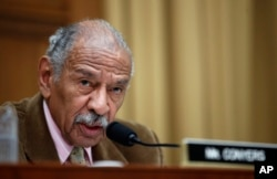 FILE - Rep. John Conyers, D-Mich., speaks during a hearing on Capitol Hill, in Washington, April 4, 2017.