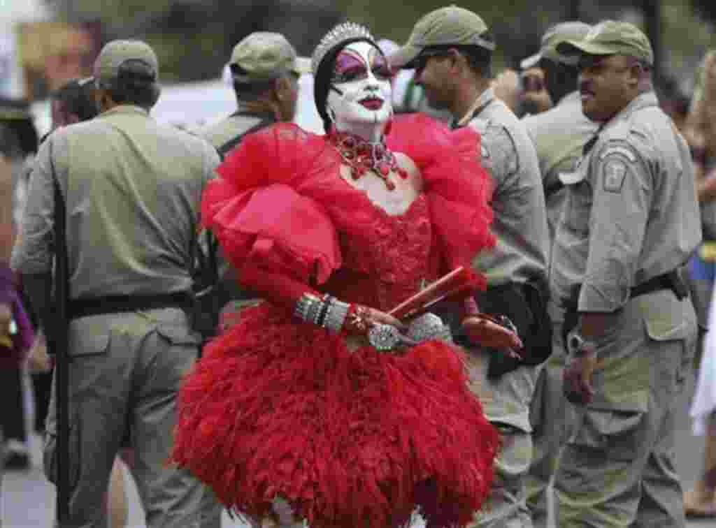 A reveler takes part at the Banda de Ipanema carnival parade in Rio de Janeiro, Brazil, Saturday, Feb. 19, 2011. Hundreds of people gathered Saturday during one of the many parades which take place in the city before the famed 'Carnival' which this year r