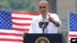 奥巴马总统在华盛顿乔治城河畔公园讲话,谈经济与交通运输问题。(2014年7月1日)