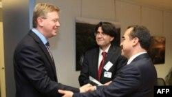 Adalet Bakanı Sadullah Ergin AB'nin genişlemeden sorumlu üyesi Stefan Füle'yle (solda)