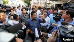 FILE: Cambodia's Prime Minister Hun Sen speaks to the media after registering for next year's local elections, in Kandal province, Cambodia September 1, 2016. (REUTERS/Samrang Pring)