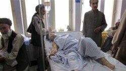یکی از مجروحین در انفجار لوگر، افغانستان. ۲۵ ژوئن ۲۰۱۱