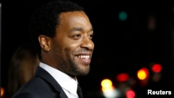 FILE - Cast member Chiwetel Ejiofor poses at a special screening of '12 Years a Slave' at the Directors Guild of America.