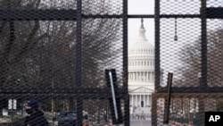 Security surrounds the U.S. Capitol in Washington, Friday, Jan. 15, 2021, ahead of the inauguration of President-elect Joe Biden and Vice President-elect Kamala Harris. (AP Photo/Susan Walsh)