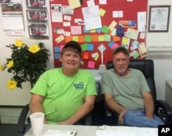 Albert Adams and Leslie Arthur, who own Big Al's Auto and Small Engine Repair, sit in their offices in Logan, West Virginia, May 11, 2016. They quit their jobs in the mines when they figured the industry wouldn't bounce back and started this shop to try to build a life after coal.