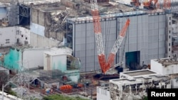 An aerial view shows the No.3 reactor building at Tokyo Electric Power Co. [TEPCO]'s tsunami-crippled Fukushima Daiichi nuclear power plant in Fukushima Prefecture, July 18, 2013.