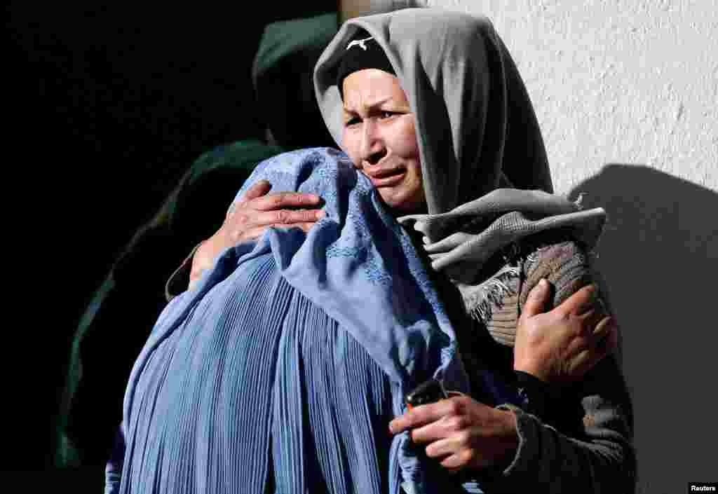 Afghan women mourn inside a hospital compound after a suicide attack in Kabul, Afghanistan.