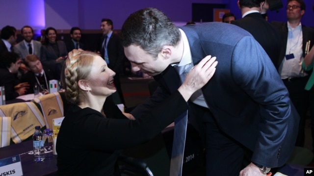 Yulia Tymoshenko, left, leader of Batkivshchyna, (Ukraine) greets Vitali Klitschko leader of UDAR (Ukraine) at the European People's Election Congress in Dublin, Ireland, March 6, 2014.