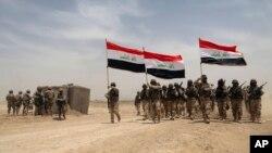 Американские военнослужащие участвовали в совместных учениях с иракскими военными в пригороде Багдада. Ирак. 27 мая 2015 г.