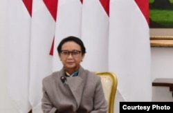 "Menlu Retno Marsudi dalam KTT Luar Biasa G20 ""Virtual"" di Istana Negara, Jakarta, 26 Maret 2020.(foto: Setpres RI)."