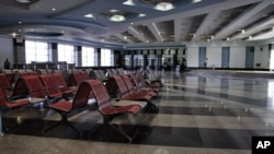 FILE - An empty arrival hall is seen at the Sharm el-Sheikh Airport in south Sinai, Egypt, Nov. 9, 2015. After an October 2015 crash of a Russian passenger jet on the Sinai Peninsula that left 224 people dead Russia is resume flights to Egypt, President Abdel Fatah al-Sissi announced Thursday.