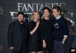 FILE - Actors Dan Fogler (from left) Alison Sudol, Katherine Waterston and Eddie Redmayne pose for photographers for the film 'Fantastic Beasts and Where to Find Them,' at a central London hotel, Oct. 13, 2016.