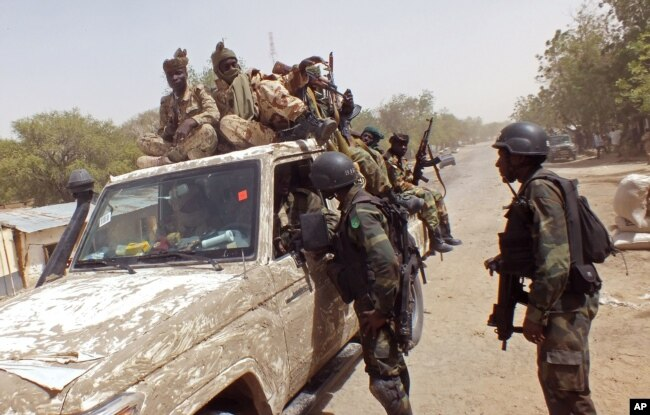 FILE - In this photo taken Feb. 19, 2015, Cameroon soldiers check a truck on the border between Cameroon and Nigeria as they combat regional Islamic extremists force's including Boko Haram.