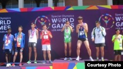 Thay Sokunthim won a gold medal for the 200 meter race at the Special Olympic World Games in Los Angeles, July 25th to August 2, 2015. (Courtesy photo of Cambodian Special Olympic Delegation)