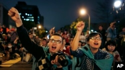 FILE - Students cheer on speakers during a gathering to mark the first anniversary of student groups stormed the parliament in Taipei, Taiwan, March 18, 2015.