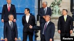NATO Secretary General Jens Stoltenberg, Poland's President Andrzej Duda, Greek Prime Minister Alexis Tsipras, U.S. President Donald Trump, Portugal's Prime Minister Antonio Costa, Hungarian Prime Minister Viktor Orban pose for a group photo in the park o