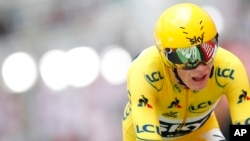 Britain's Chris Froome, wearing the overall leader's yellow jersey, crosses the finish line during the 20th stage of the Tour de France cycling race, in Marseille, France, July 22, 2017.