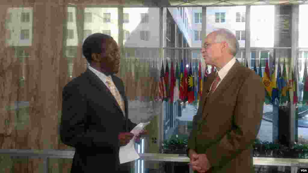 US Special Envoy for South Sudan and Sudan Donald Booth (R), shown here with South Sudan in Focus host John Tanza, urged South Sudan on Monday not to fall back into violence, but refused to call the overnight unrest in Juba an attempted coup.