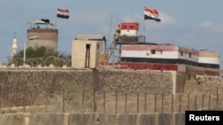 An Egyptian soldier stands guard on the border between Egypt and southern Gaza Strip, Sept. 8, 2013.
