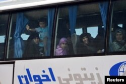 FILE - People are seen in the bus released by militants from Idlib, Syria May 1, 2018. (SANA/Handout via Reuters)