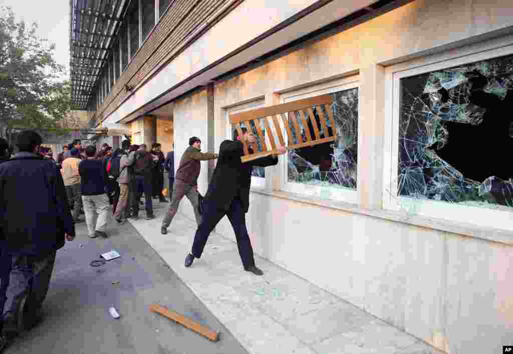 Nov. 29: Iranian protesters break the windows of a British Embassy building in Tehran, Iran. The mob moved into the diplomatic compound two days after Iran's parliament approved a bill that reduces diplomatic relations with Britain following London's supp