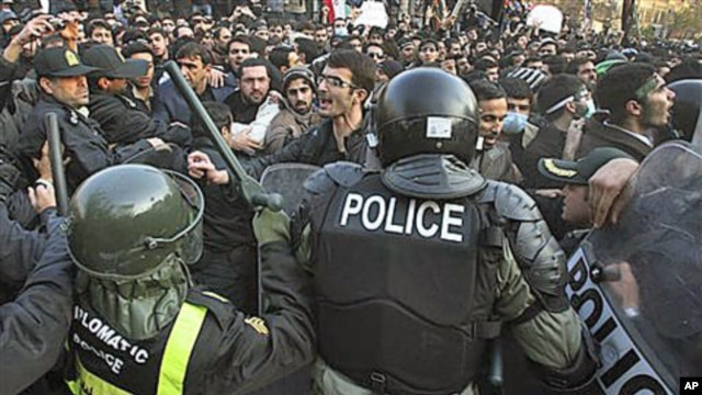 Iranian police prevent some protesters from entering the British Embassy, in Tehran, Iran, November 29, 2011.