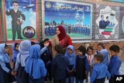 Hameeda Danesh meets with children during her parliamentary campaign.