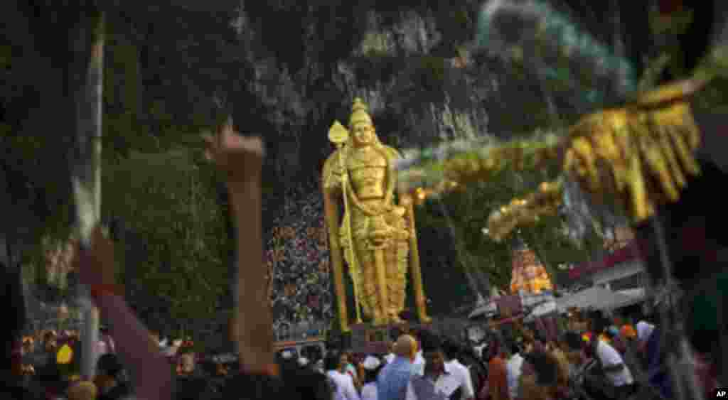 Batu Caves temple in Kuala Lumpur, which is more than 100-years-old, is a popular tourist destination with a flight of steps, consisting of 272 steps leading toward a temple in the cave. On Thaipusam, some one million devotees and tourists go to Batu Cave