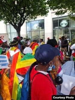 People protesting outside the Zimbabwe Embassy in London on Wednesday. (Courtesy Photo)